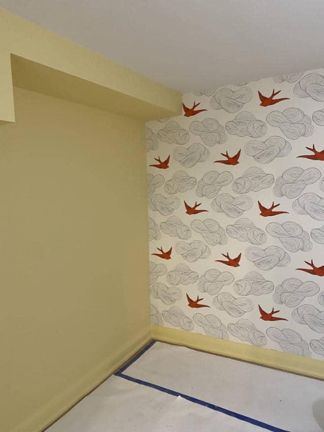 red bird wallpaer installed in bedroom