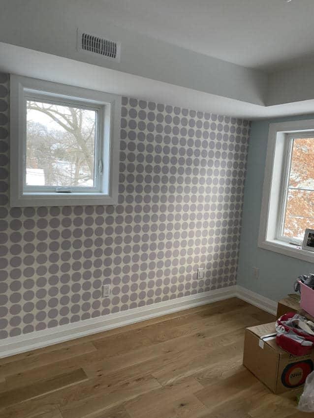 large grey polkadot wallpaper installed in bedroom