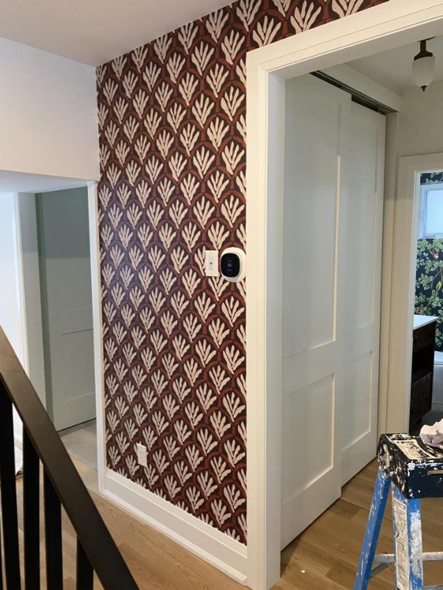 installation of retro wallpaper in hallway